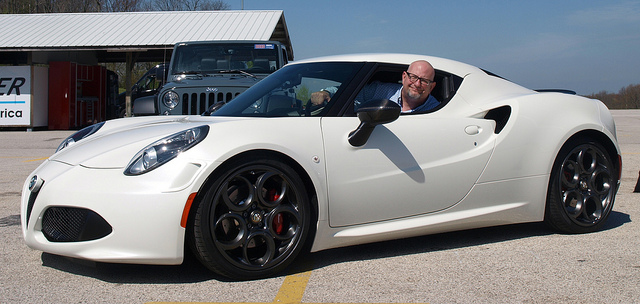 The author inside of a 2015 Alfa Romeo 4C - photo provided by Victory & Reseda for Lavender Magazine