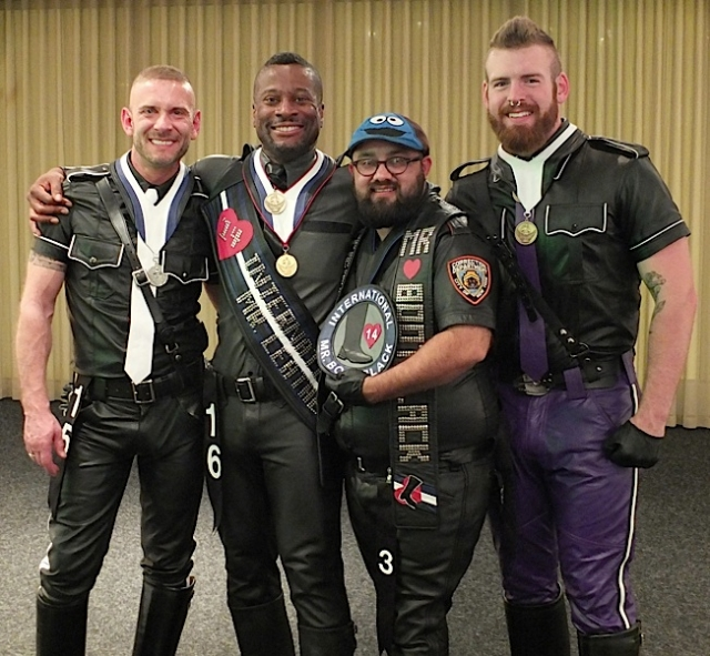 Left to right: IML first runner-up Steve Dupont; International Mr. Leather 2014 Ramien Pierre; International Mr. Bootblack 2014 Scout; and IML second runner-up Cody Troy. Photo by Steve Lenius.