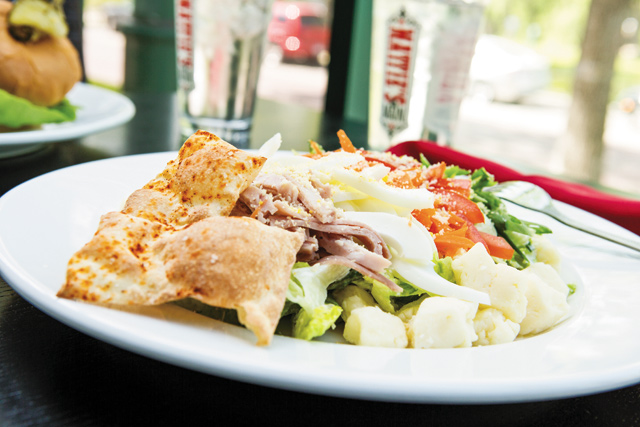 VIP Salad: Think Chef's Salad meets Cobb Salad. Romaine lettuce tossed with buttermilk scallion dressing, ham, Roma tomatoes, julienned egg whites, with cheese curds. Eat small bites of the mixed salad, then finish with a bite of the cheese curd…OMG this is good! Photo by E. Katie Holm