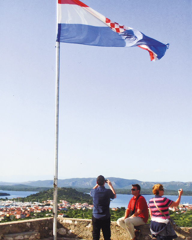 The Croatian flag flies over the fort at Hvar, an island in the Adriatic. Photo by Carla Waldemar
