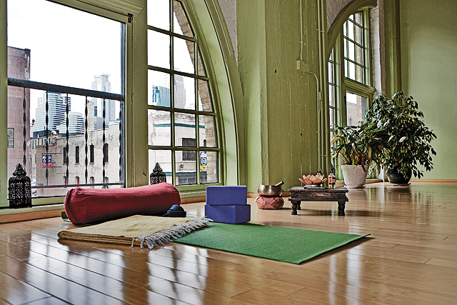 Bolsters, blankets, foam blocks, and mats are used in special ways for larger bodies to make the yogis more comfortable. Photo by Mike Hnida