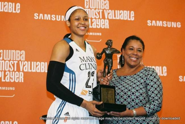 Pictured left to right: Maya Moore 2014 WNBA MVP Laurel Richie President WNBA