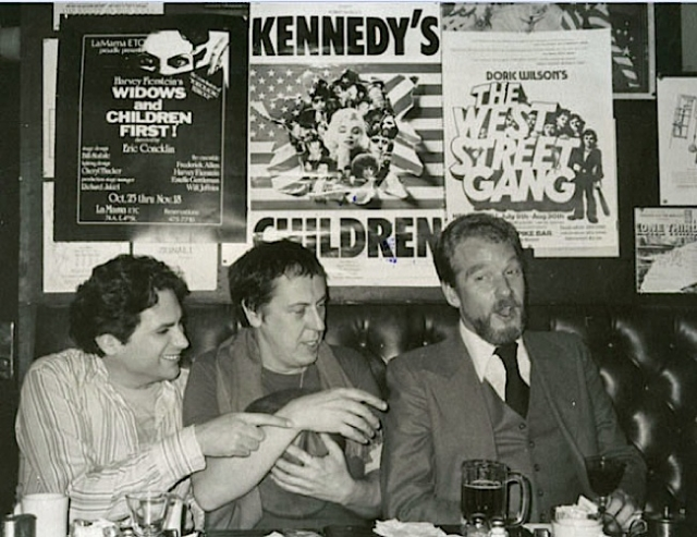 Gay playwrights Harvey Fierstein, Robert Patrick and Doric Wilson under their posters in Phebes Bar, NYC, 1980.