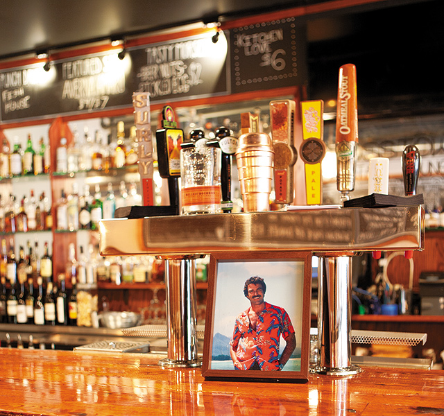 The Lyn 65's spirit animal: Magnum P.I. guards the bar. Photo by Hubert Bonnet