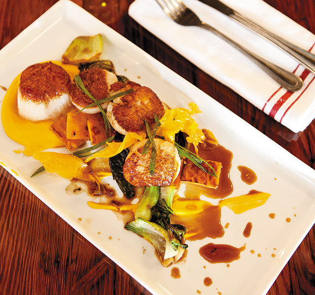 Scallops with sweet potato three ways. Photo by Hubert Bonnet
