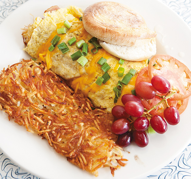 Dion's Omelet filled with turkey, bacon, green onions, tomato, and cheddar cheese. Photo by Hubert Bonnet