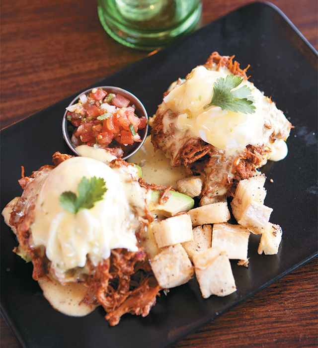 Benedicts with carnitas and turkey mole. Photo by Hubert Bonnet