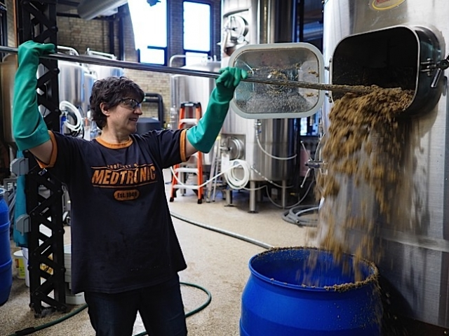 Deb Loch clears out the Lauder Tun. Photo by Ethan Boatner.