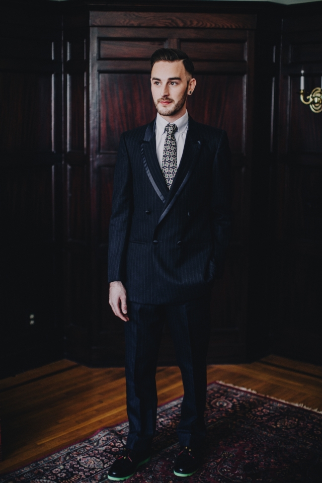 "Custom upcycled double-breasted navy blue tuxedo with satin trim ($225) from Dapper Dan Michael; ""Grown Man Solar Red"" resoled Florsheim shoes with green glow bricklayer sole by Greenwich Vintage Co. Photography by Matt Lien Photography"