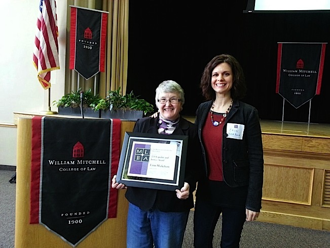 Lynn Mickelson, being presented with the 2015 Equity and Justice Award from the Minnesota Lavender Bar Association. The award was presented by one of her many former interns, Erin Keyes, now serving as the Assistant Dean of Students, University of Minnesota Law School. Photo courtesy of Lynn Mickelson