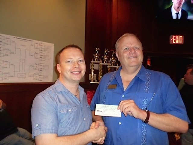 TCGPL Treasurer Brant Vlasak (left) presented a check for $1,500 to The Aliveness Project Food Shelf, represented by Tim Marburger, Director of Fundraising and Special Events. Photo by George Holdgrafer.