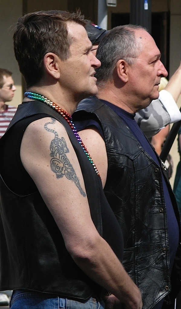 Colin Spriestersbach and Carl Gscheidmeier in 2008 at the retirement ceremony for the original leather pride flag. Photo by Bill Schlichting.
