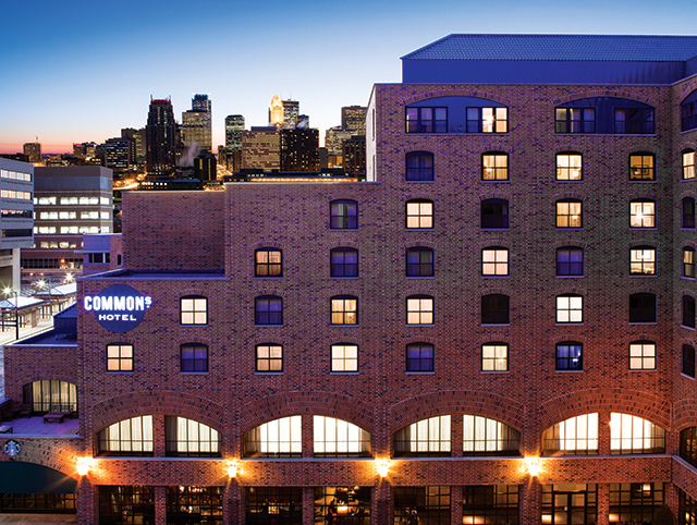 The Commons Hotel is set in the heart of the University of Minnesota's Minneapolis campus, with the downtown skyline present in the background. Photo courtesy of The Commons Hotel