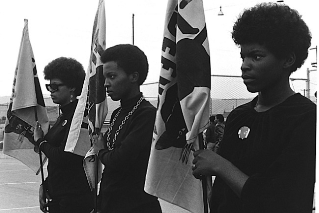 Women holding Panther flags. Photo courtesy of Pirkle Jones and Ruth-Marion Baruch.