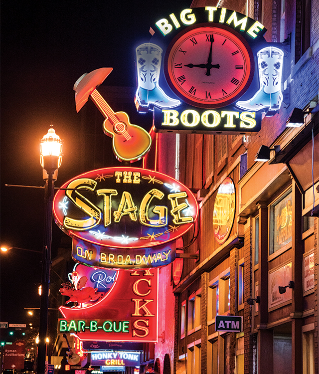 Neon lights on Broadway at night in Nashville, Tennessee.