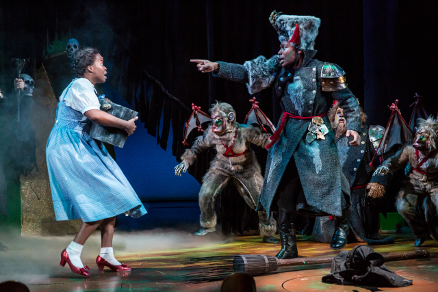 John Jamison, as a Winky, announces that Dorothy (Traci Chapman) killed the Wicked Witch of the West. Photo by Dan Norman