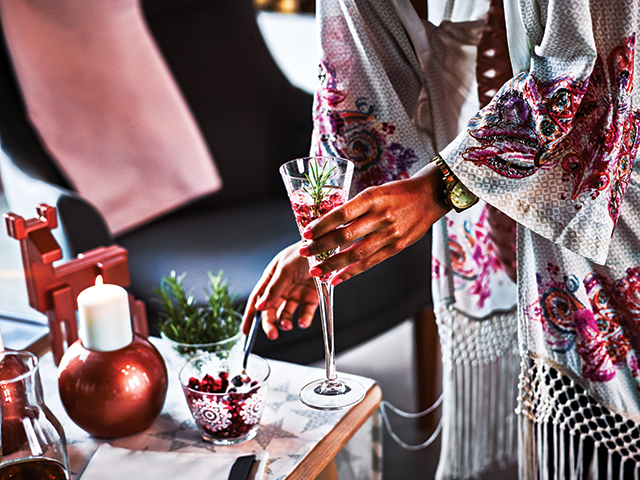 Add a punch of color by serving a colorful signature cocktail after dinner. Serve drinks in Ikea's Vinter 2015 champagne flutes ($6.99 per two-pack) for an inexpensive, yet elegant presentation.