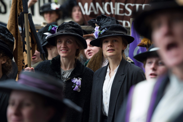 Violet Miller (Anne-Marie Duff) and Maud Watts (Carey Mulligan) campaign for women's voting rights in director Sarah Gavron's Suffragette. Photo Credit : Steffan Hill / Focus Features