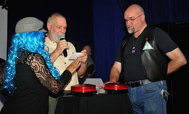 Two contestants race to see who can hit the buzzer first. Photo by Minnesota Leather Pride/Chuck Bevolo.