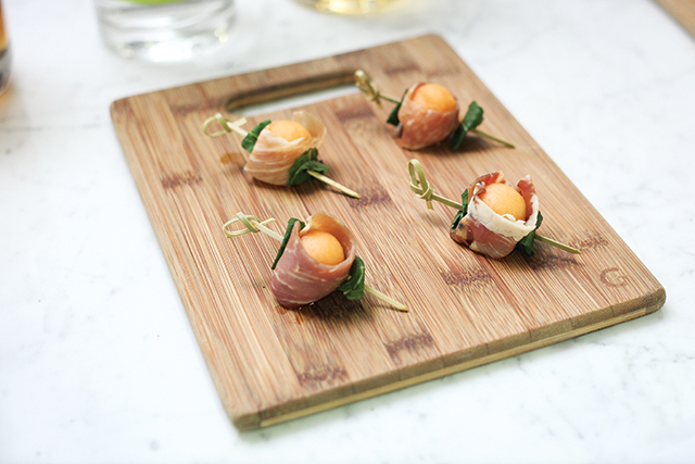 Prosciutto Melon Bite with cantaloupe, mint, and balsamic.