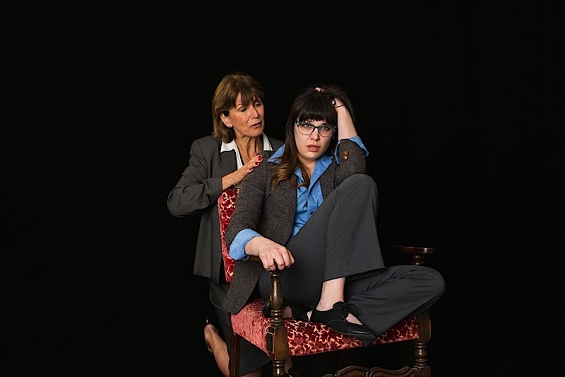 Caroline Kaiser (kneeling) & Molly Pach (seated). Photo by Richard Fleischman.