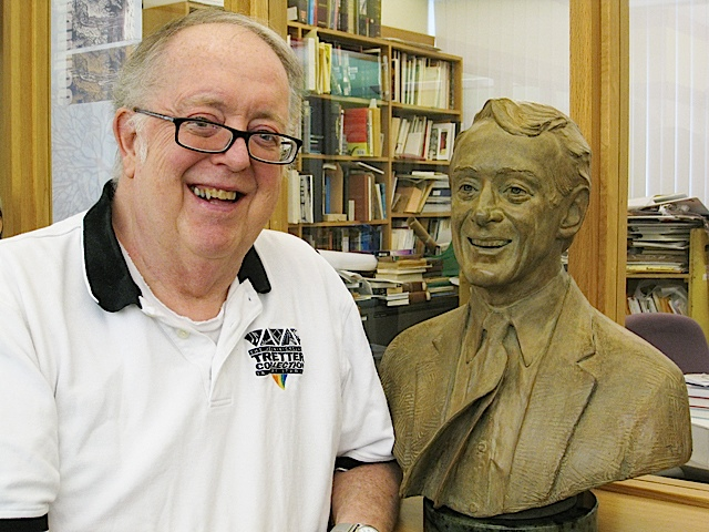 Founder Jean-Nickolaus Tretter with a bust of Harvey Milk. Photo by Lisa Vecoli