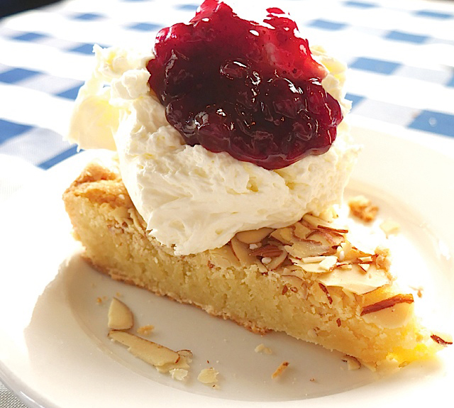 The coveted almond cake covered with whipped cream and lingonberries.