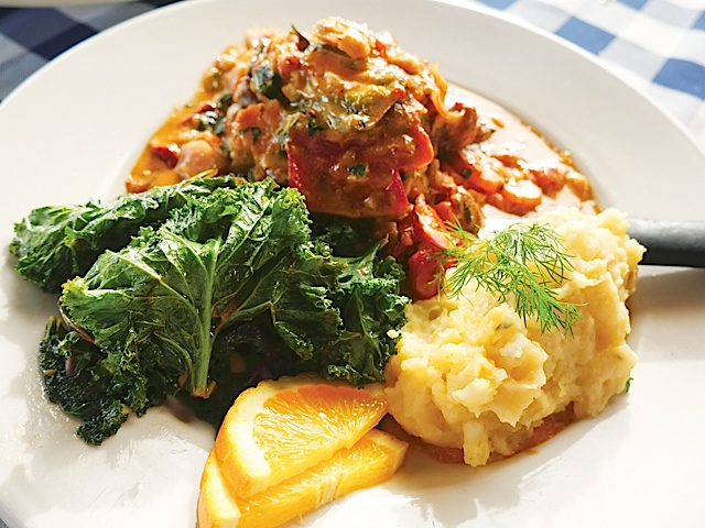 The Berkshire braised pork shank with mashed root vegetables and kale.