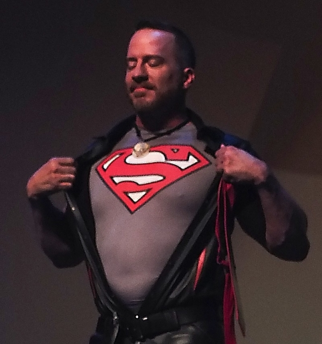 Brian Donner revealing his Superman shirt during his speech at IML 2015. Photo by Steve Lenius