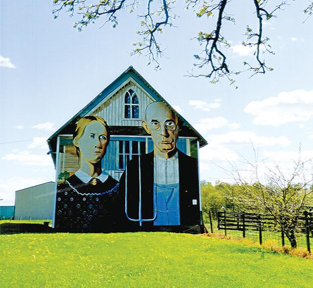 "Farmhouse painted a la ""America Gothic""."