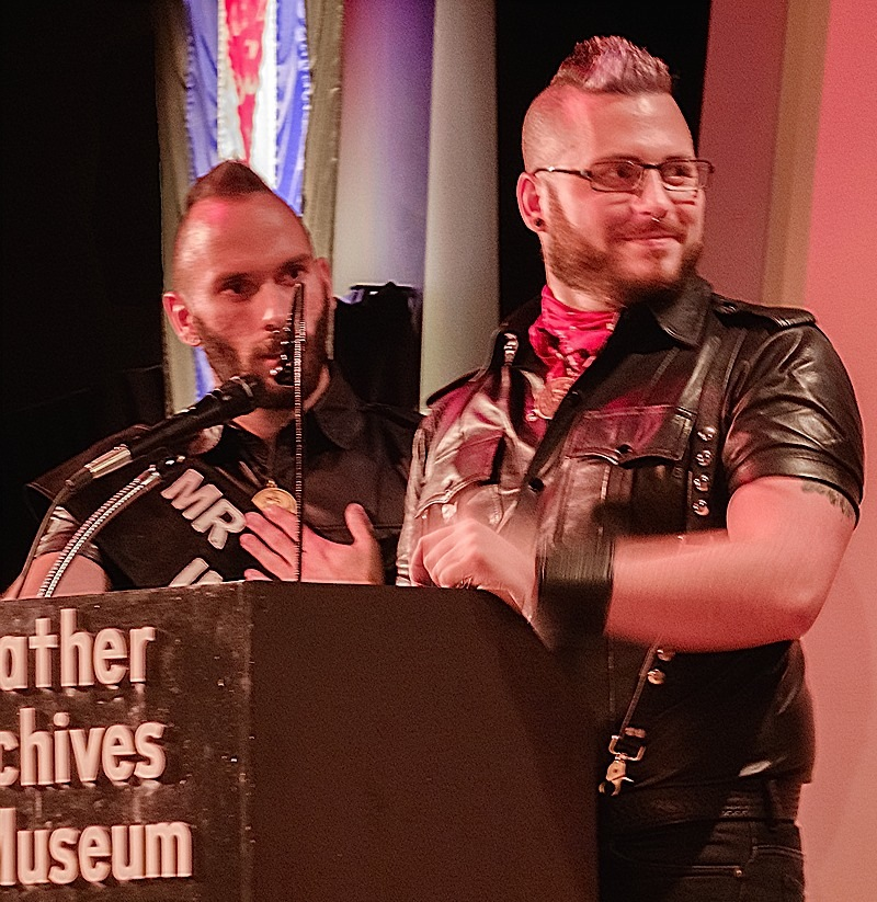 Left to right: Mr. Minneapolis Eagle 2015 Ren Rushold and Mr. Twin Cities Leather 2015 Steven Patton onstage at Thursday evening's roast of International Mr. Leather 2015 Patrick Smith and International Mr. Bootblack 2015 Bamm-Bamm. The roast was held at Chicago's Leather Archives & Museum. Photo by Steve Lenius.