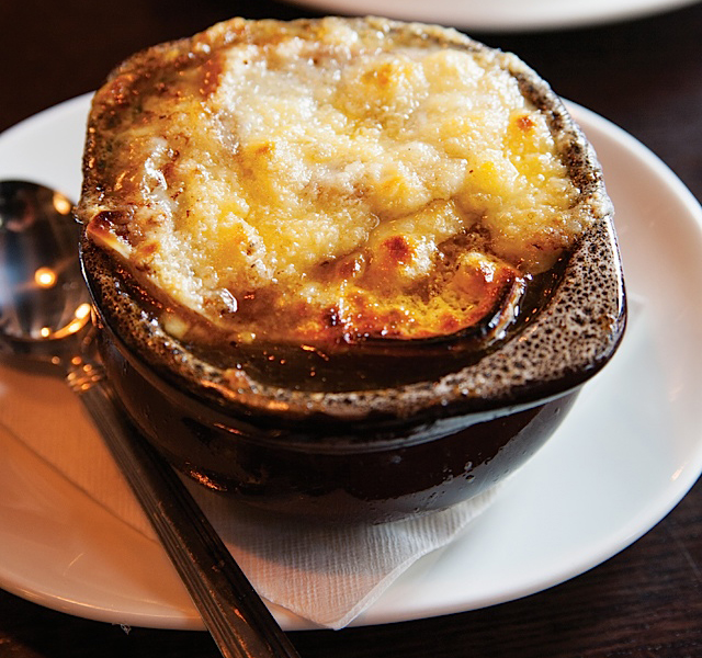 The perfectly executed french onion soup with crouton and gruyere.