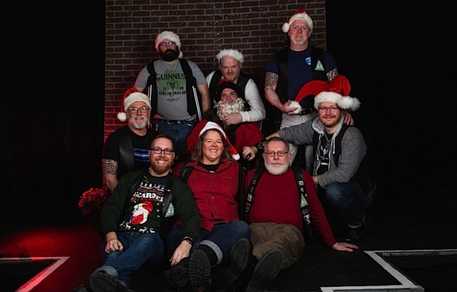 "At ""The Nightmare of Christmas,"" members of the Atons of Minneapolis surround Kinky Santa. Photo by Andrew Bertke."