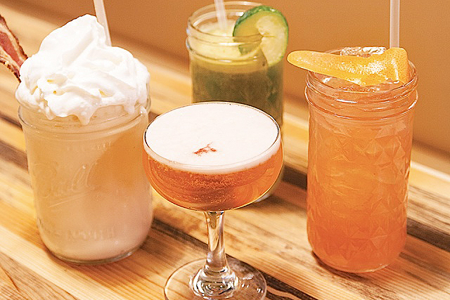 One adult milkshake and three preschool drinks: a Malted Maple Royale of whiskey, ice cream, and candied bacon; the Ginger Rogers with cucumber, pear, and lemon and ginger shrub; a grapefruit soda; and Jeanette's with strawberry syrup, lime juice, and aloe vera juice.