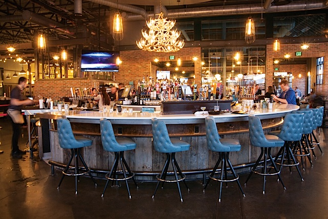 The 360-degree bar is one of the many centerpieces of Punch Bowl Social.