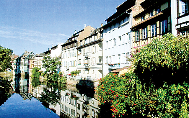 Strasbourg (France) medieval half-timbered houses reflected in the river. Photo by Carla Waldemar