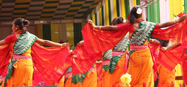 Sari-clad dancers perform at the annual tribal political-social gathering in Assam. Photo courtesy of India Beckons