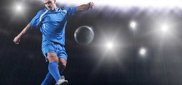 soccer player doing kick with ball on football stadium  field  i