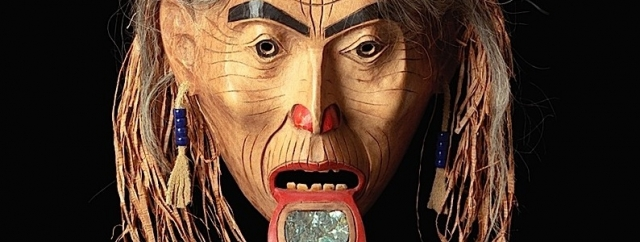 Freda Diesing. Haida, 1925-2003. Mask, Old Woman With Labret, 1974. Alder wood, paint, hair, cedar bark, abalone, glass beads, moose hide, bone or plastic. 12 1/4 x 9 7/8 x  4 3/8 in. Courtesy of the Royal BC Museum, RBCM15057. Image RBCM 15057 by Freda Diesing, courtesy of the Royal BC Museum and Archives. © Canadian Westcoast Art.