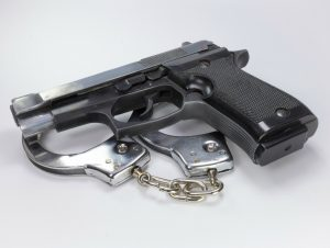 Gun and handcuffs 300x226