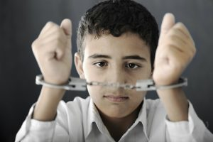 Child with handcuffs on 300x200