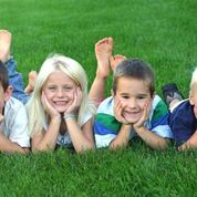 Smiling children on lawn