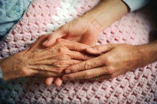 Hands pink blanket