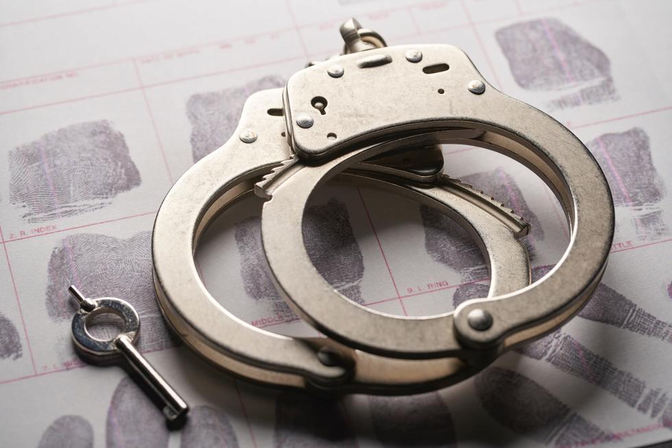 Handcuffs on fingerprint sheet