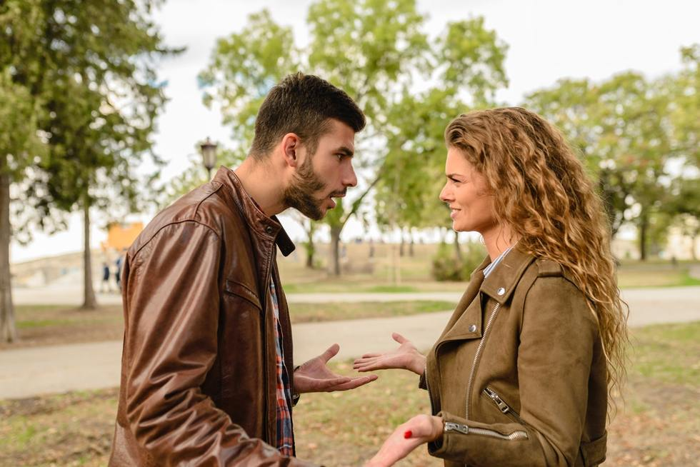 Man and woman wearing brown leather jackets 984950