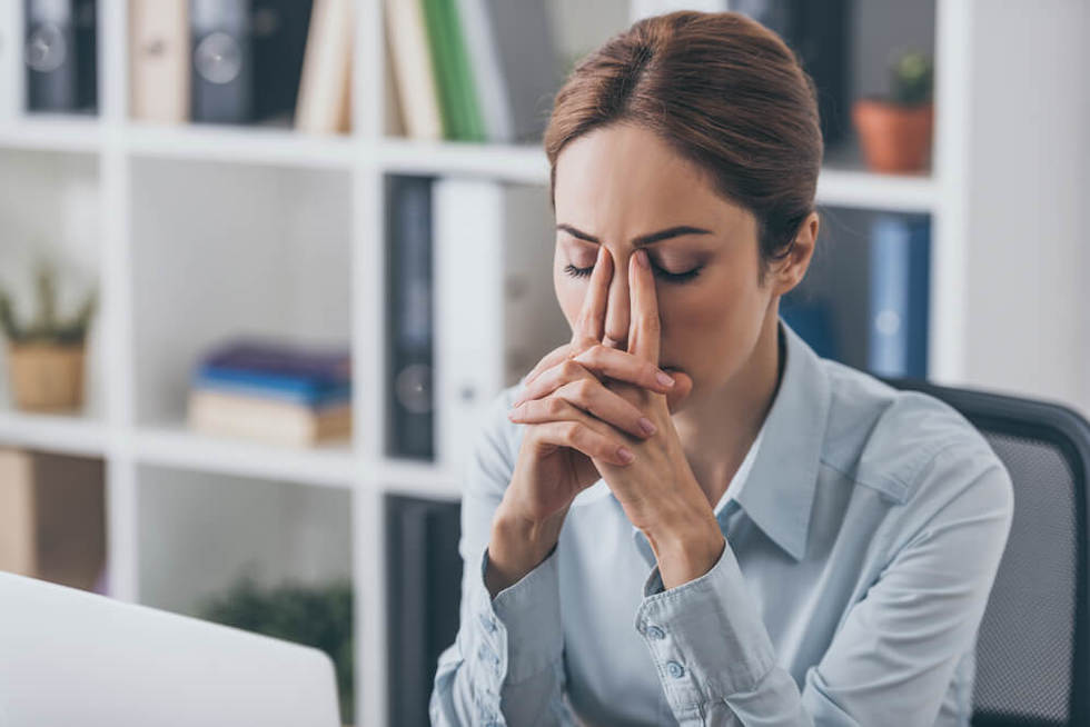 woman upset about hostile work environment resulting from sexual harassment
