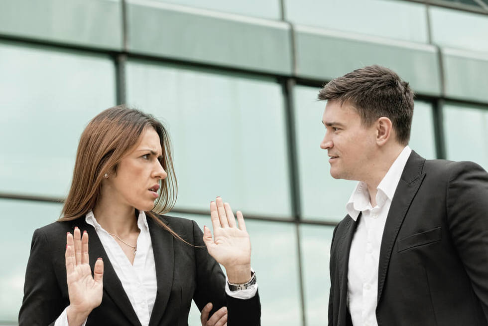 woman rejecting sexual harassment