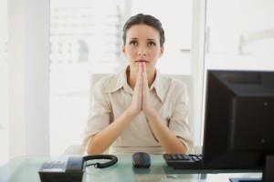 Business woman praying 300x200