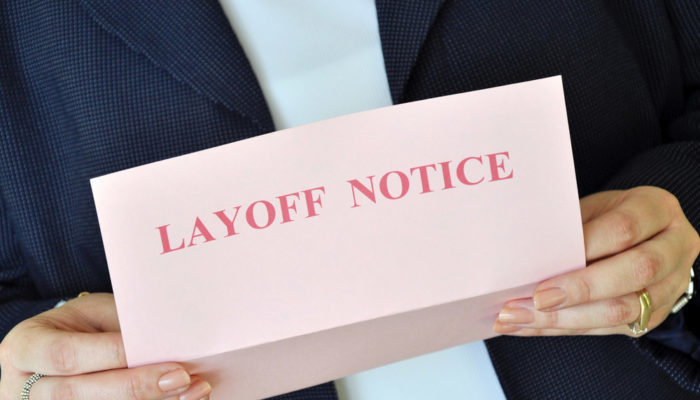 Man holding layoff notice 700x400
