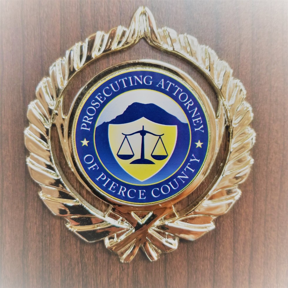 Criminal Defense Lawyer presented with a badge for past service as a prosecutor